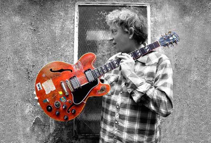 The red guitar was made in 1959, around the time Elvin Bishop moved to the South Side of Chicago and entered the blues scene. Photo by Joshua Temkin, Delta Groove Music.
