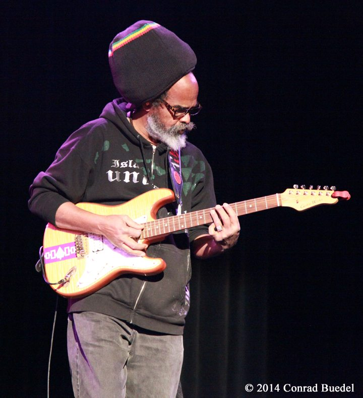 Melvin Glover on electric guitar.