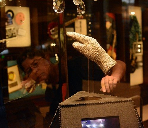 Susan Riley places Michael Jackson's glove in a glass case. Tim Parsons/ Tahoe Onstage