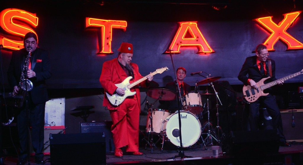 The bandleader of the C.D. Woodbury Band dons a fez for the crowd at Alfred's in Memphis.