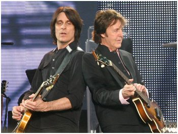 Rusty Anderson onstage with Paul McCartney.