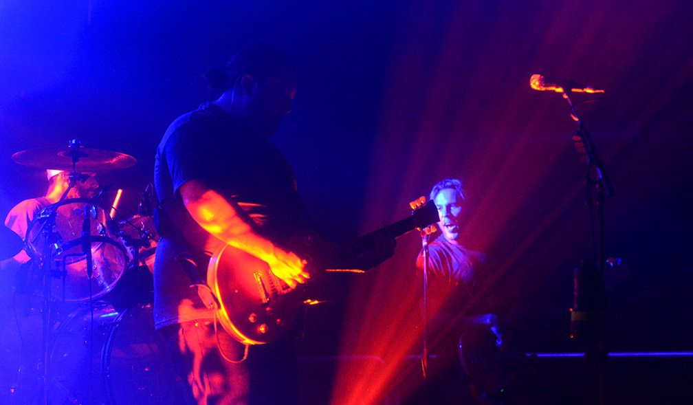 Iration's Joe Dickens, left, Micah Pueschel and Adam Taylor flint through shadows and lights at Cargo. Tim Parsons/ Tahoe Onstage