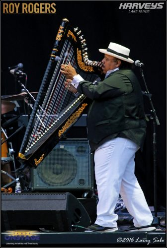 "Roy Rogers: ""People get confused when I say Carlos plays the harp. I'm pretty sure he can't put that thing in his mouth."""