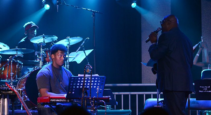 Porter's youngest and oldest sons, Tevien, drums, and Cliff Jr., keyboards, keep their eyes on dad. Tim Parsons / Tahoe Onstage