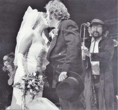 Country Dick Montana lassos Vicki and Joey Harris as they tie the knot in front of 30,000 at San Diego's Street Scene in 1990.