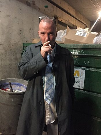 Doug Stanhope takes a break outside the hotel. Photo by Brett Erickson