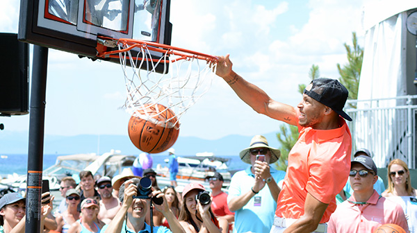 Steph Curry slam dunks at the party 17th hole last summer. Tim Parsons / Tahoe Onstage