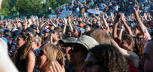 Phish fans rise as the band members take the stage, opening the tour at the Lake Tahoe Outdoor Arena at Harveys.