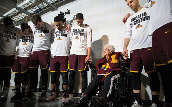 Sister Jean Dolores-Schmidt leads Loyola University Chicago  players in prayer before competing in the Elite Eight round in the NCAA Tournament against Kansas State at Philips Arena in Atlanta, GA., on Saturday, March 24, 2018. (Photo: Lukas Keapproth)