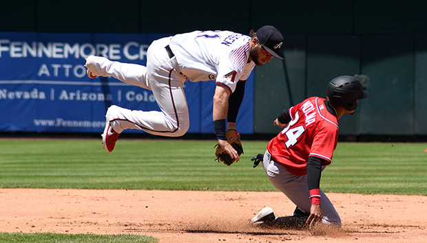 Wyatt Mathison gets airborne when Alburquerque's Nelson Molina slides into second base on Monday at Greater Nevada Field. Tim Parsons / Tahoe Onstage photos