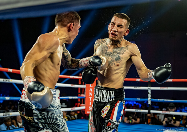 Jason Sanchez, right, goes toe to to with Oscar Valdez in June.