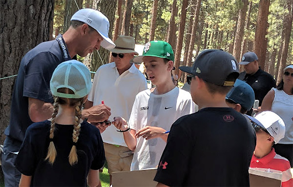 Matthew Fehr gets Mike Modano's autograph on Friday at the American Century Championship at Edgewood Tahoe Golf Course. Isaiah Burrows / Tahoe Onstage