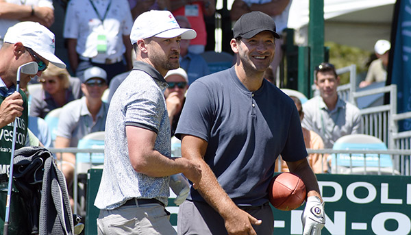 ACC first-round leader Tony Romo carries a football and hangs out with Justin Timberlake at No. 17. Tim Parsons / Tahoe Onstage