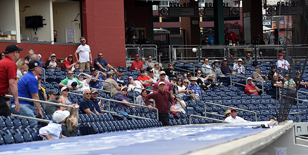 Fans in Greater Nevada Field watch a foul ball bounce off of the dugout. Tim Parsons / Tahoe Onstage photos