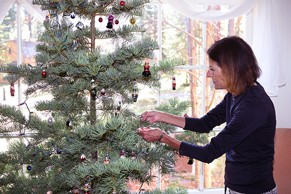Judy Riva decorates a tree at the entrance of Valhalla's Grand Hall at the Tallac Historic Site.