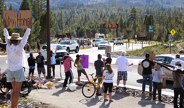 Tahoe residents greet motorists Friday at the Meyers roundabout, one of five protests around the lake. Tim Parsons / Tahoe Onstage photos