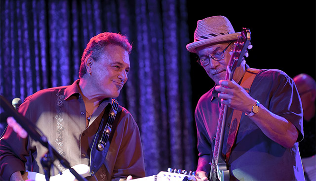 Smiling Buddy Emmer is back in Tahoe onstage with Andy Santana. Tahoe Onstage photos by Tim Parsons